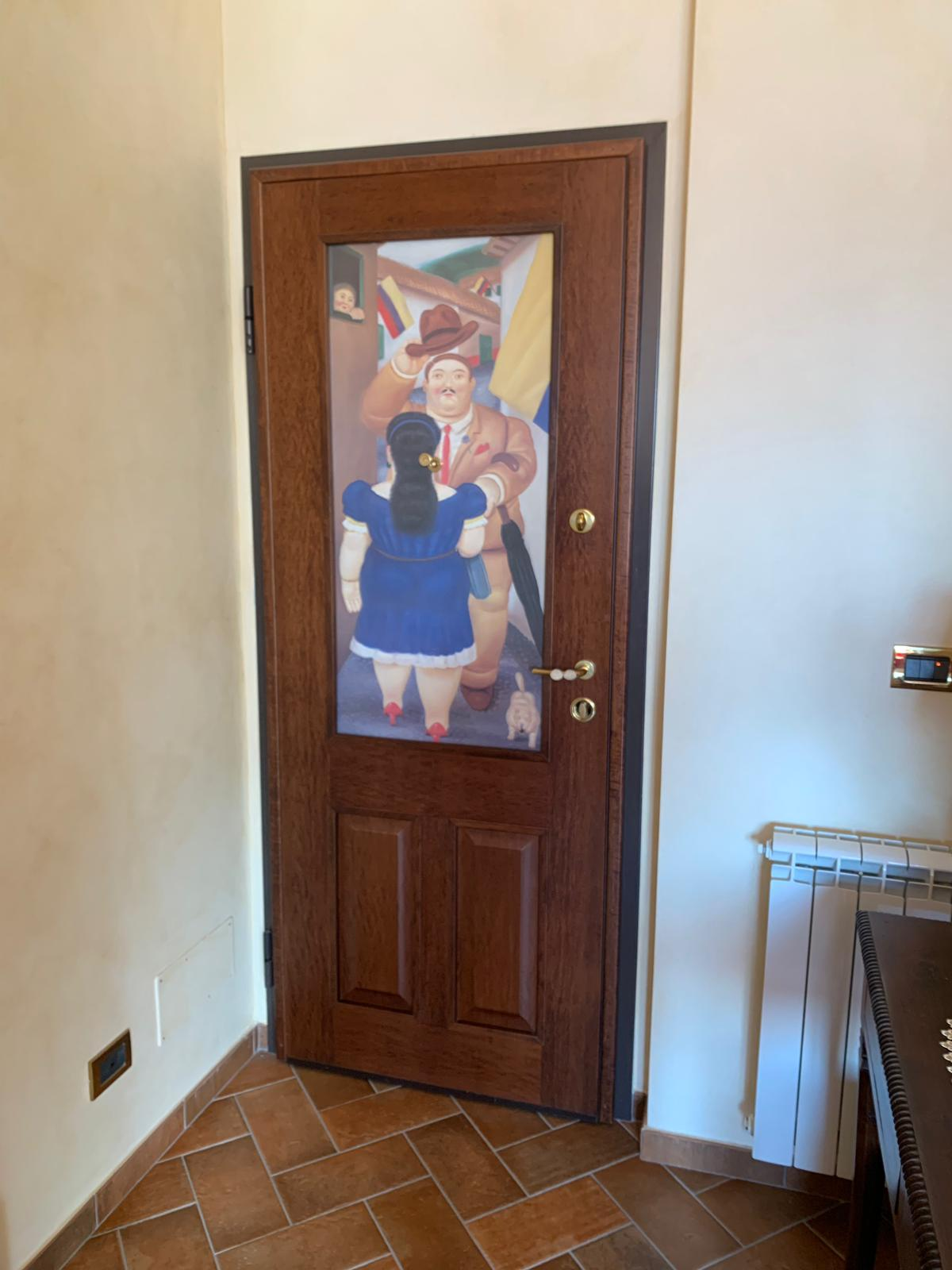quadro botero su porta entrata